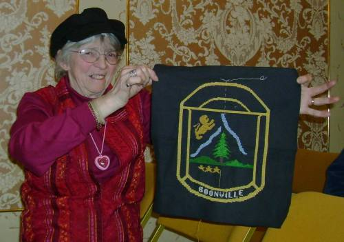 Member Peg Sawyer shows piece she made for the club's coverlet.